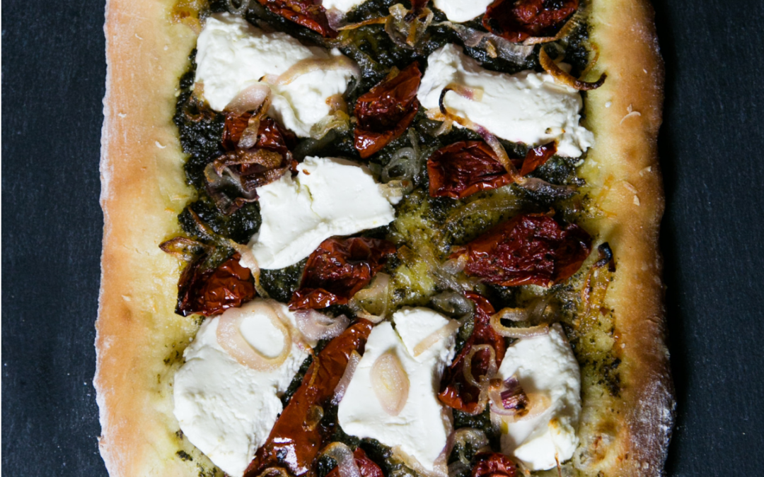 Beet Greens Pesto Pizza with Caramelized Shallots, Goat Cheese & Roasted Tomato