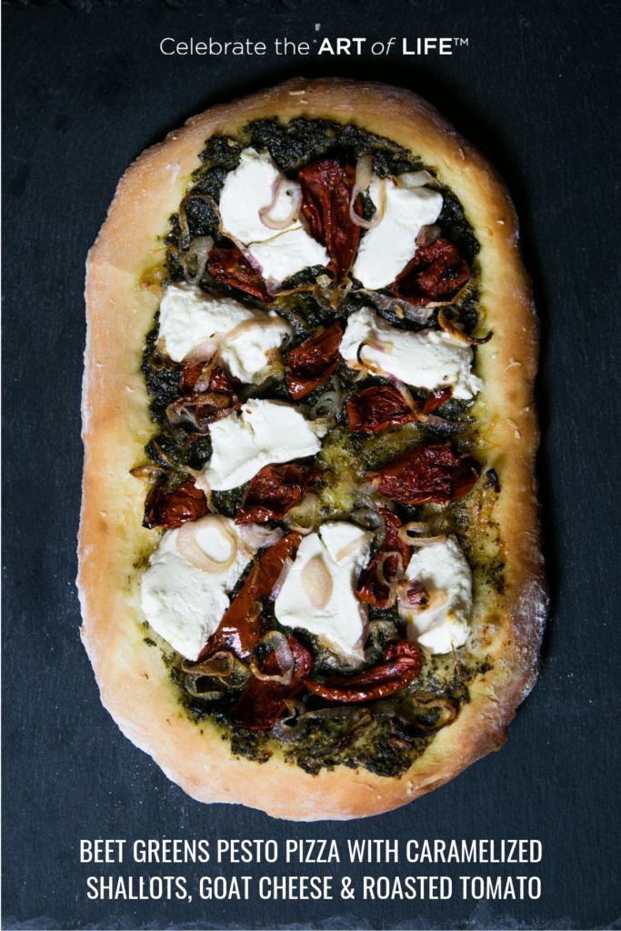 BEET GREENS PESTO PIZZA WITH CAREMELIZED ONION, GOAT CHEES E & ROASTED TOMATO