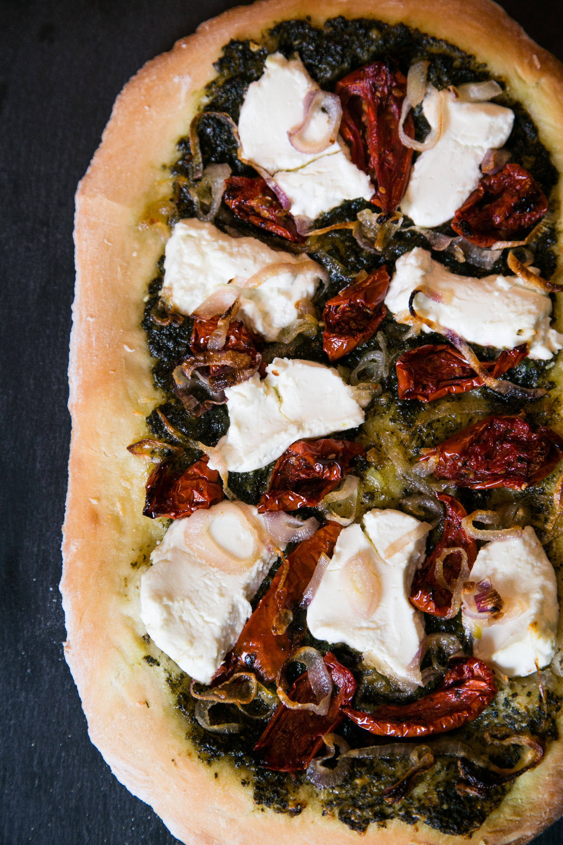 Beet Greens Pesto Pizza with Caramelized Shallots, Goat Cheese and Roasted Tomato